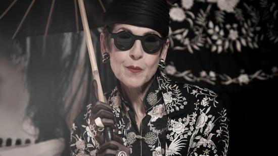 Black and white photo of style icon Tziporah Salamon with parasol