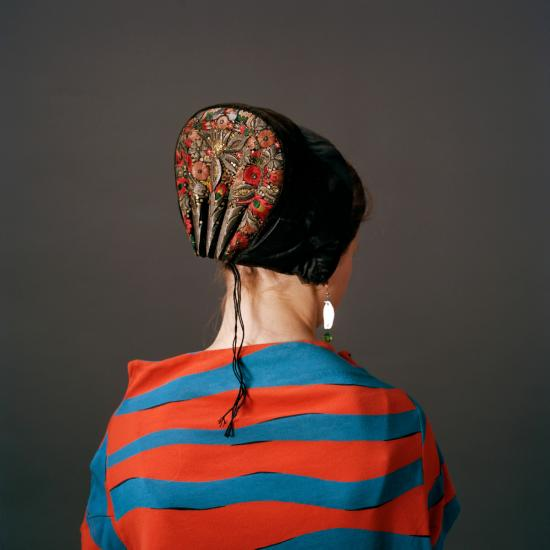 Photograph of back of woman wearing danish bonnet