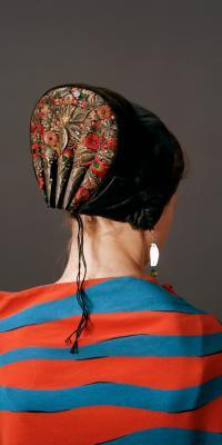 Photograph of back of woman wearing danish bonnet